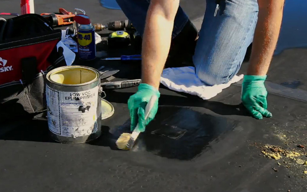 Apply a thin coat of epdm roof primer to repair area where roof patch will be applied.