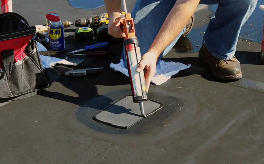 Apply a bead of EPDM lap sealant around the leading edge of the repair patch to ensure protection against water infiltration.