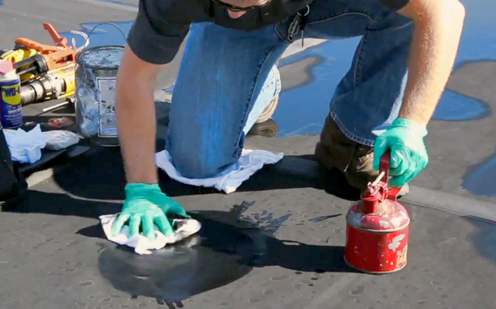 Prepare EPDM roof for repair by cleaning the area properly.