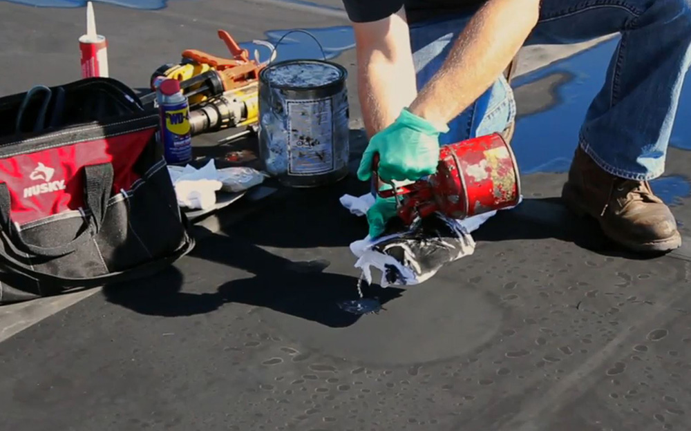 In order to clean the surface of the roof use a cleaner that does not leave a residue on the membrane after the area dries. Many manufacturers recommend a cleaner such as Simple Green or Spic n' Span.